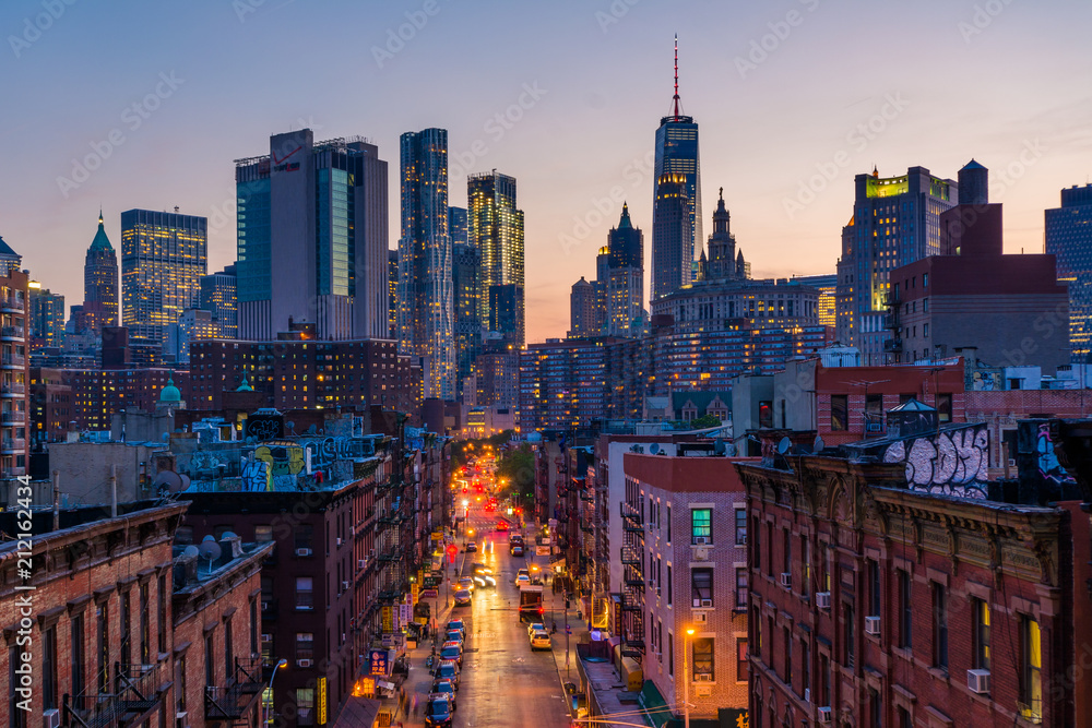 Fototapeta View of Madison Street and Lower Manhattan at sunset from the Manhattan Bridge in New York City
