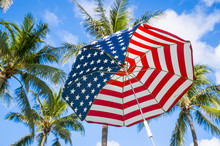 Abstract View Of Stars And Stripes USA Flag Sun Umbrella With Palm Trees