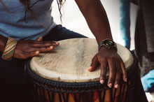 Close Up Of Hands Of A Woman Playing A Drum.