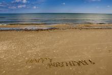 Happy Birthday Wish In The Sand At The Seashore