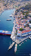 Aerial brid's eye photo taken by drone of Yalos, iconic port of Symi island, Dodecanese, Greece