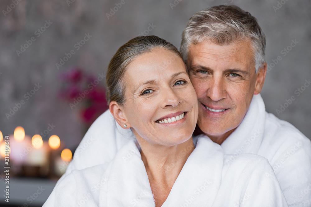 Fototapeta Mature couple in bathrobe at spa