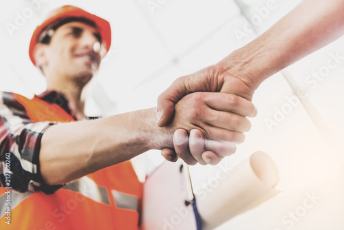 Obraz Close up. Engineer Greeted Man with Handshake. - fototapety do salonu