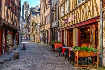 FototapetaCozy street with timber framing houses and tables of restaurant in Rouen, Normandy, France