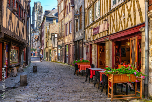 Valokuvatapetti Cozy street with timber framing houses and tables of restaurant in Rouen, Norman