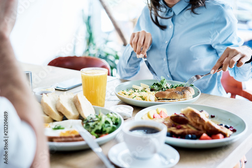 Couple having healthy breakfast in modern restaurant Fototapeta