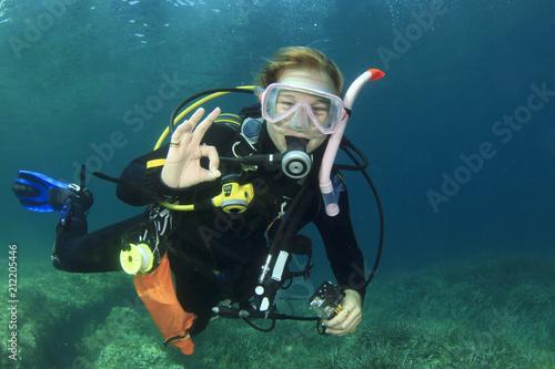 Female scuba diver okay signal Canvas Print