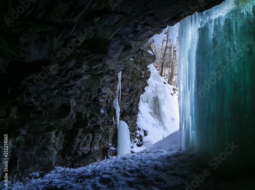 Canvas Prints Light pink Icy Cave and Iced Waterfall