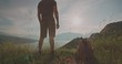 young man standing on top of mountain, enjoying view of sky with beautiful clouds in sunset - zen concept 4k
