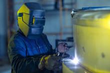 Welder In Industrial Plant Welding Tanks
