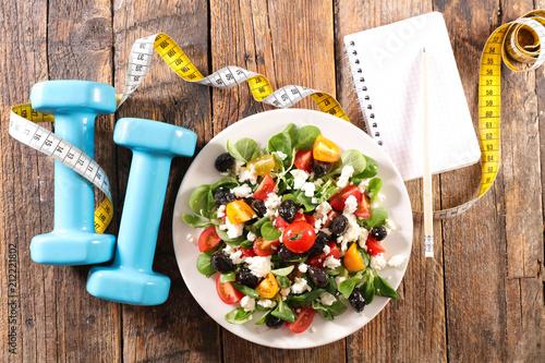 Obraz diet food concept, vegetable salad and dumbbel - fototapety do salonu