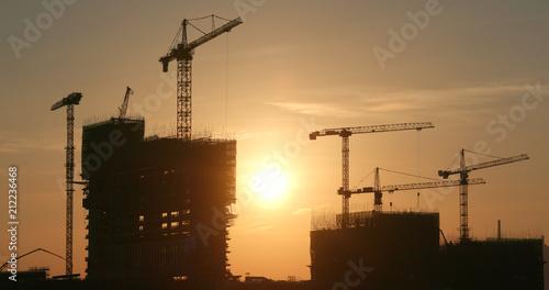Foto op Canvas Stad gebouw Sunset construction site in city