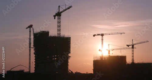 Foto op Canvas Stad gebouw Construction Site under sunset