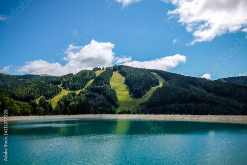 Poster Bergen Beautiful mountain landscape with view of lake Speicherteich in the Alps of Austria on sunny summer day.