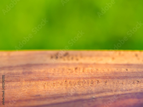 Abstract wooden texture with blurry green background.