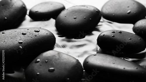 Obraz na plátně Grey wet pebbles background