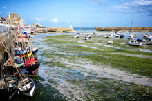 BARFLEUR: Fishing And Recreational Boats At Low Tide In The Harbor Of Barfleur. Barfleur Is A Picturesque Fishing Village In Basse Normandy. France.