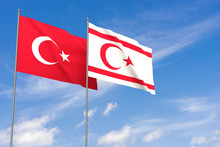 Turkey And Turkish Republic Of Northern Cyprus Flags Over Blue Sky Background.