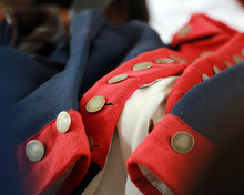 Military Uniform Typical Of American Revolutionary War Period With Red, White And Blue Clotth And Metal Buttons