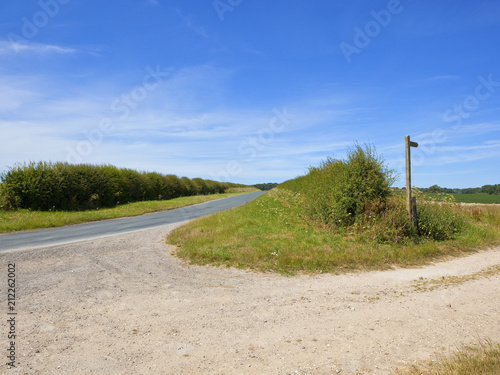 Tuinposter Beige bridleway and country road