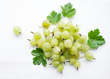 Juicy Berries Of A Gooseberry On A White Wooden Background. Summer Berries