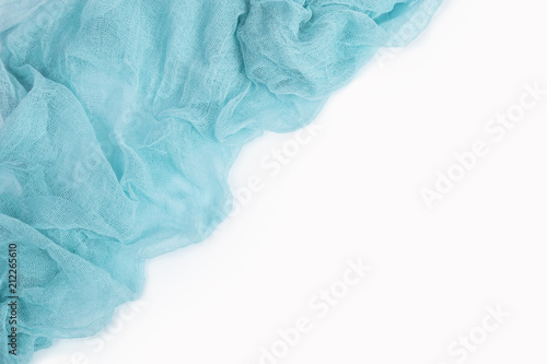 Fotografie, Obraz  Light blue gauze fabric isolated on white background. Top view.