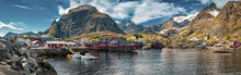 Panoramic Shot Of A Village, Moskenes, On The Lofoten In Northern Norway. Norwegian Fishing Village, With The Typical Rorbu Houses.  Mountain In Background