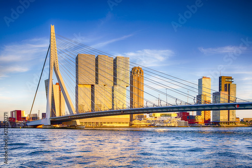 Foto op Plexiglas Rotterdam Famous Travel Destinations. Attractive View of Renowned Erasmusbrug (Swan Bridge) in Rotterdam in front of Port and Harbour. Picture Made Before the Sunset.