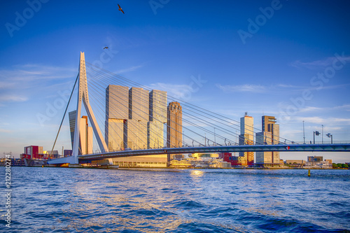 Keuken foto achterwand Rotterdam Famous Travel Destinations. Attractive View of Renowned Erasmusbrug (Swan Bridge) in Rotterdam in front of Port and Harbour. Picture Made Before the Sunset.