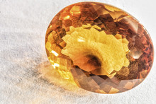 Beautiful Citrine Quartz Crystal Faceted On White Surface
