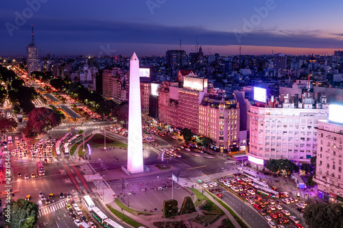 Fotografie, Tablou Aerial view of Buenos Aires and 9 de julio avenue at night with purple light - B