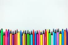 Elementary School Supply. Set Of Various Colorful Markers On White Desk Background, Flat View