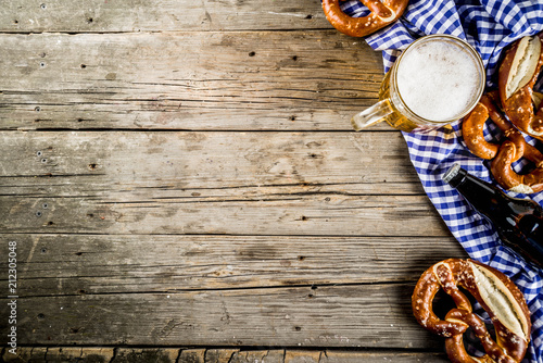 Oktoberfest food menu, bavarian pretzels with beer bottle mug on old rustic wood Canvas Print