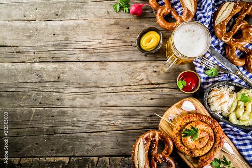 Photo Oktoberfest food menu, bavarian sausages with pretzels, mashed potato, sauerkrau