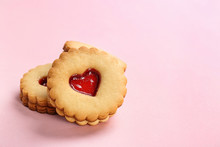 Traditional Christmas Linzer Cookies With Sweet Jam On Color Background
