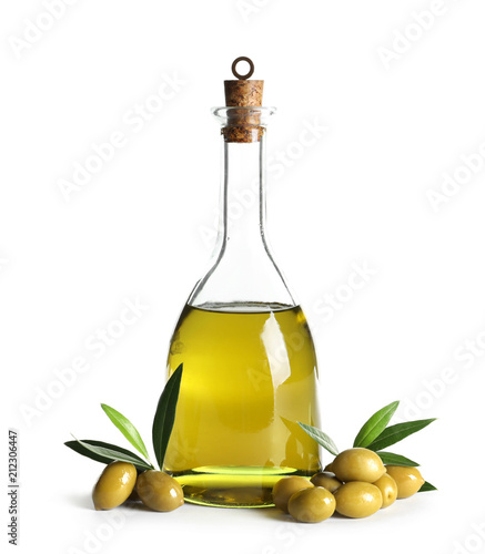 Glass bottle with fresh olive oil on white background
