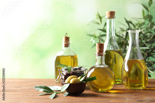 Composition with fresh olive oil on table