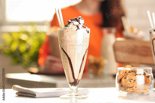 Cadres-photo bureau Lait, Milk-shake Glass with delicious milk shake on table indoors