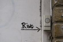 Ring The Doorbell On The White Door