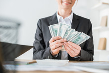 Cropped Image Of Smiling Financier Counting Money In Office