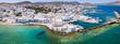 canvas print picture - Panoramablick auf das traditionelle Fischerdorf Naousa auf der Insel Paros mit türkisem Wasser und weißen Häusern, Kykladen, Griechenland