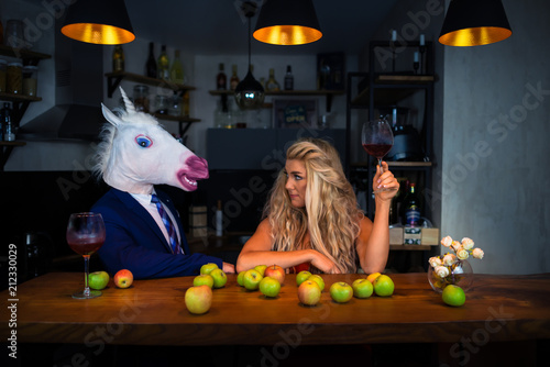 Canvas Unusual couple spend time together at the bar counter in stylish apartments with wine and food