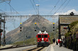 The famous swiss mountain red train Bernina Express arrives from St.Moritz to Ospizio Bernina Station