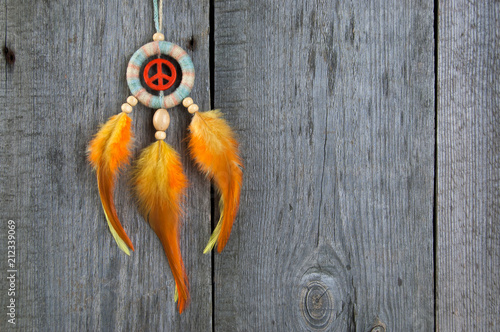 Bright dream catcher with an orange peace sign