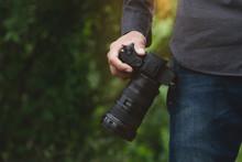 Close-up On Photographer Hand Holding Camera