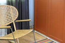 Wicker Chair.Rocking Chair In White.Chair On The Balcony. Rattan Rocking Chairs On The Wooden Balcony.Wicker Chair.