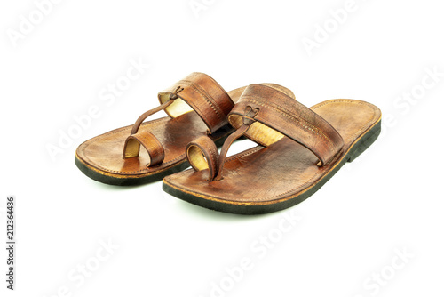 ea75f629f520a Front view of a pair of brown traditional indian leather sandals isolated  on white background.