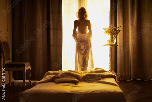 Acrylic Prints womenART Sensual blonde at the window