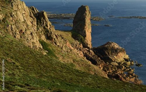 Tuinposter Kust Pinnacle rock, Les Landes, Jersey, U.K. 150ft granite monolith of granite prched on the coast.