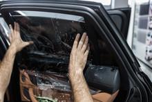 Car Tinting - Worker Applying ...